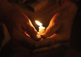 candle within hand